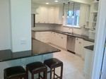 White Painted cabinets with Uba Tuba Granite